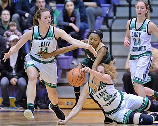 St. Vincent-St. Mary's Dream Cherry (center) fights for a loose ball against West Branch's Hannah Ridgway (left), Shannon Wolfe (bottom) and Sarrah Tennefoss (right) during the first quarter of their Division II regional semifinal game Tuesday at Barberton High School. (Jeff Lange/ABJ/Ohio.com correspondent)