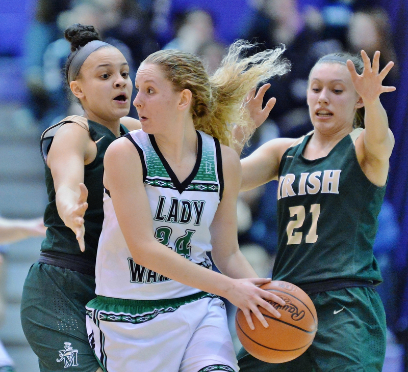St. Vincent-St. Mary's Kendall Miller (left) and Maria Dobson (right) double-team West Branch's Sarrah Tennefoss during the second quarter of their Division II regional semifinal game Tuesday at Barberton High School. (Jeff Lange/ABJ/Ohio.com correspondent)