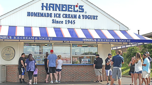 Patrons line up outside the Handel's Homemade Ice Cream and Yogurt stand on dollar cone day in Boardman last summer. The company has entered into a legal dispute with Kenneth Schulenburg, a California franchisee it accuses of going rogue.