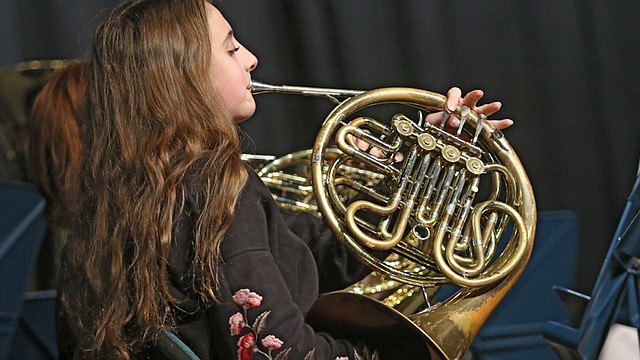 Zoey Smith, a member of the Struthers High School Concert Band, plays a French horn during the school's performance at the fifth annual Mahoning Valley Festival of Bands at Hubbard High School.