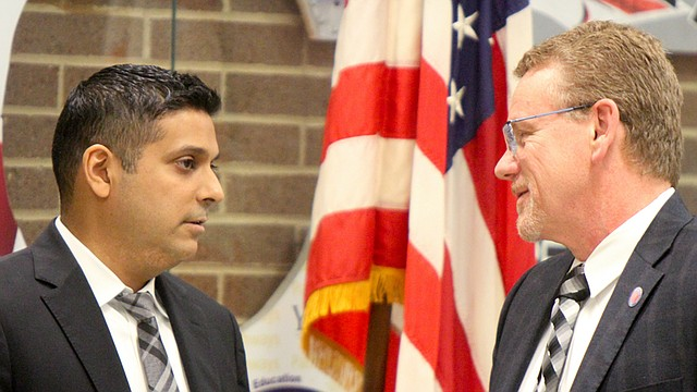Krish Mohip, CEO of Youngstown schools, left, has a conversation with John Richard, the new member of the Youngstown Academic Distress Commission. The commission met Wednesday at Choffin Career and Technical Center to discuss its future in overseeing the school district.