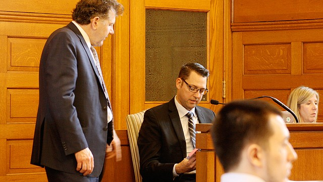 Chris Becker, assistant Trumbull County prosecutor, discusses the mapping that Bill Moskal, special agent with the Ohio Bureau of Criminal Investigation, seated near Becker, put together with records from Austin Burke's cellphone company. Burke is at right. He is charged with aggravated murder of Brandon Sample last year.