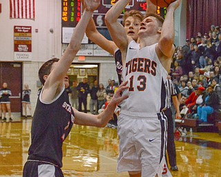 Connor Tamarkin (#13) of Howland tries to make a basket as Isaiah Torreance (#1) and Carson Ryan (#5) of Struthers block during their Thursday, March 8, 2018 game at Boardman High School...Photo by Scott Williams - The Vindicator.
