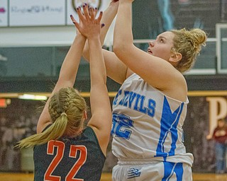 Leslie Burnip takes a jumper from the baseline with Kirsten Shoup of Dalton defending in a Division IV regional semifinal at Massillon Perry High School on Thursday. 