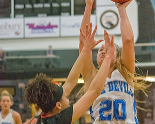 Autumn Oehlstrom of Lisbon attempts to score from the paint as Jalyssa Turner of Dalton defends in a Division IV regional semifinal at Massillon Perry High School on Thursday.