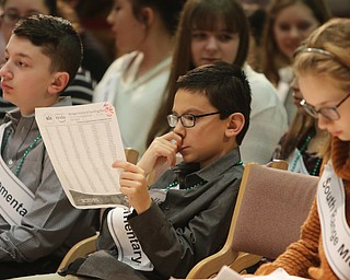 ROBERT  K. YOSAY | THE VINDICATOR..The 85th Spellling Bee at YSU and Kilcawley Center - 44 spellers came  down to  Mackenzie Sambroak 5th grader from Roosevelt Elementary in McDonald...Kyle England Lowellvill Elementar ponders some wors before the start of the BEE