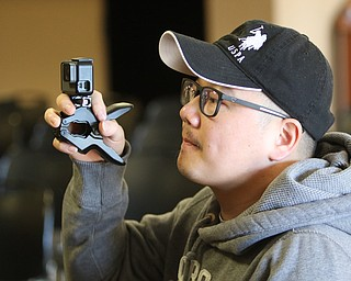 ROBERT  K. YOSAY | THE VINDICATOR..The 85th Spellling Bee at YSU and Kilcawley Center - 44 spellers came  down to  Mackenzie Sambroak 5th grader from Roosevelt Elementary in McDonald...Yu Zeng creates a moment with his GO PRO his soneJay Zheng --BL Miller  school