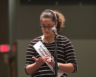 ROBERT  K. YOSAY | THE VINDICATOR..The 85th Spellling Bee at YSU and Kilcawley Center - 44 spellers came  down to  Mackenzie Sambroak 5th grader from Roosevelt Elementary in McDonald...Nina C Dill of Montessori of the Mahoning Valley spells out her word on her hand