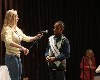 ROBERT  K. YOSAY | THE VINDICATOR..The 85th Spellling Bee at YSU and Kilcawley Center - 44 spellers came  down to  Mackenzie Sambroak 5th grader from Roosevelt Elementary in McDonald...Helping adjust the microphone - is Julia Miglets a past winner as McGuffey Elementary Gabriel Adams 4th grade