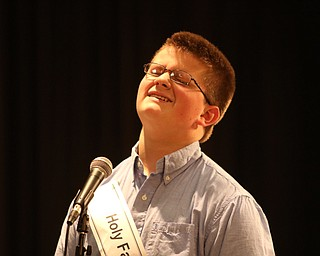 ROBERT  K. YOSAY | THE VINDICATOR..The 85th Spellling Bee at YSU and Kilcawley Center - 44 spellers came  down to  Mackenzie Sambroak 5th grader from Roosevelt Elementary in McDonald...Ouch as Holy Family  David Vuksanovich 8th grade reacts to missing his word
