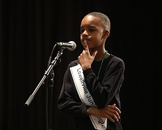 ROBERT  K. YOSAY | THE VINDICATOR..The 85th Spellling Bee at YSU and Kilcawley Center - 44 spellers came  down to  Mackenzie Sambroak 5th grader from Roosevelt Elementary in McDonald...Hmmm Lowellville Jr High  Braylen Dabney.. thinks about his word