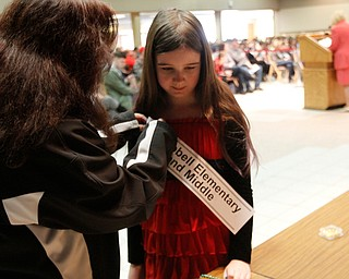 ROBERT  K. YOSAY | THE VINDICATOR..The 85th Spellling Bee at YSU and Kilcawley Center - 44 spellers came  down to  Mackenzie Sambroak 5th grader from Roosevelt Elementary in McDonald...Karen Donald Campbell Elementary and Middle -  gets her banner form her mom Michele