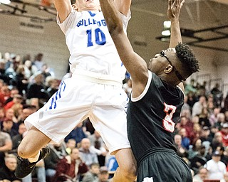 Lakeview's AJ McClellan puts up a shot as Struther's Kevin Traylor defends during the Division II District Title game at Boardman on Saturday. Lakeview won 72-59...Photo by Dianna Oatridge.