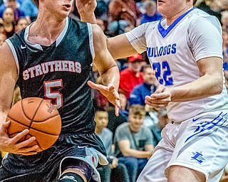 Struthers' Carson Ryan looks to pass around Lakeview defender Drew Munno during the Division II District Title game in Boardman on Saturday. Lakeview won 72-59.