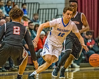 Lakeview's AJ McClellan splits Struthers defenders Tyrese Hawkins (left) and Kevin Traylor (right) as he dribble upcourt during the Division II District Title game in Boardman on Saturday. Lakeview won 72-59...Photo by Dianna Oatridge.