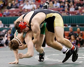 Canfield's David Crawford, top, works against St. Vincent-St. Mary's David Heath in a 182 pound championship match during the Division II Ohio state wrestling tournament at the Ohio State University Saturday, March 10, 2018. Crawford won 5-3. (Photo by Paul Vernon)
