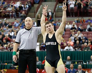 Canfield's David Crawford, right, is declared the winner over St. Vincent-St. Mary's David Heath in a 182 pound championship match during the Division II Ohio state wrestling tournament at the Ohio State University Saturday, March 10, 2018. Crawford won 5-3. (Photo by Paul Vernon)