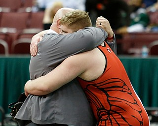 Girard's Jack DelGarbino, left, hugs his father J.T. DelGarbino after his pin on Steubenville's Tyler Ely in a 285 pound championship match during the Division II Ohio state wrestling tournament at the Ohio State University Saturday, March 10, 2018. (Photo by Paul Vernon)