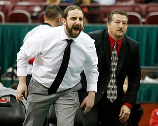 Canfield's coaches Steve Pitts, left, and David Crawford direct Tyler Stein during his 220 pound championship match against Maumee's Brandon Phillips during the Division II Ohio state wrestling tournament at the Ohio State University Saturday, March 10, 2018. Stein won 7-3. (Photo by Paul Vernon)