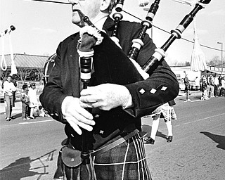 KILTED CLEVELANDER: Jim Martin of the West Side Irish-American Club of Cleveland was among the bagpipers who participated in Sunday's parade...Photo taken on March 10, 1985...Photo by Robert K. Yosay.