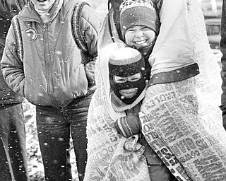 The Irish eyes of the Fitzgerald family of Pittsburgh kept smiling despite snow flurries and 20-25mph winds.  From bottom are Kenny, 6; Heather, 11; and Ruth Fitzgerald.  Robin, 14, is at her left...Photo taken March 11, 1984...Photo is by Robert K. Yosay - The Vindicator.