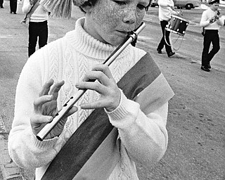 Kevin Folley of the West Side Irish-American Club Junior Fife and Drum Corps of Cleveland jauntily plays his fife for the crowd.  About half of the 170 units scheduled to perform canceled because of the weather...Photo taken March 11, 1984...Photo by Robert K. Yosay - The Vindicator.