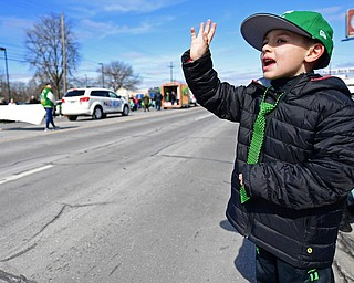 """BOARDMAN, OHIO - MARCH 11, 2018: Tyler Divto 6, of Streetsboro waives while saying """"Happy Saint Patricks Day"""" to people marching on Market Street during the Mahoning Valley St. Patrick's Day Parade. DAVID DERMER 