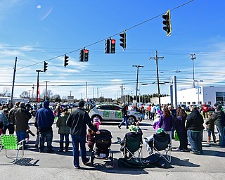 BOARDMAN, OHIO - MARCH 11, 2018: People stand along Market Street during the Mahoning Valley St. Patrick's Day Parade. DAVID DERMER | THE VINDICATOR