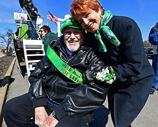 BOARDMAN, OHIO - MARCH 11, 2018: Parade grand marshal Pete Gabriel and his wife Sandy, pose for a picture during the Mahoning Valley St. Patrick's Day Parade. DAVID DERMER | THE VINDICATOR