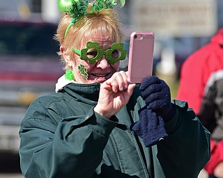 BOARDMAN, OHIO - MARCH 11, 2018: Sue Haynes of Bordman takes a photo on her cell phone on Market Street during the Mahoning Valley St. Patrick's Day Parade. DAVID DERMER | THE VINDICATOR