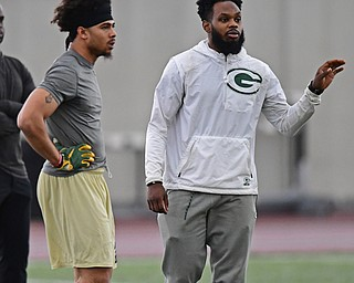 YOUNGSTOWN, OHIO - MARCH 13, 2018: Green Bay Packers scout and former YSU defensive back Brandian Ross, gives instructions to Jalyn Powell and other defensive backs during individual drills during the Youngstown State football pro day, Tuesday morning at the Watts Indoor Facility. DAVID DERMER | THE VINDICATOR