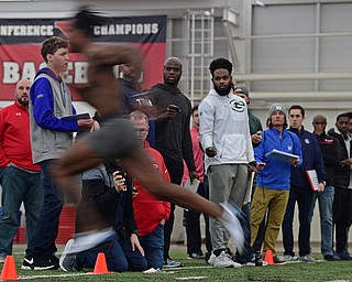 YOUNGSTOWN, OHIO - MARCH 13, 2018: Scouts from different NFL and CFL teams watch as Youngstown State's Damoun Patterson sprints through the finish line during the 40 yard dash during the Youngstown State football pro day, Tuesday morning at the Watts Indoor Facility. DAVID DERMER | THE VINDICATOR