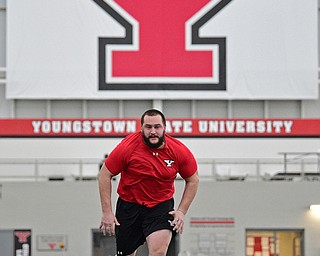 YOUNGSTOWN, OHIO - MARCH 13, 2018: Youngstown State's Justin Spencer competes during a shuttle drill during the Youngstown State football pro day, Tuesday morning at the Watts Indoor Facility. DAVID DERMER | THE VINDICATOR
