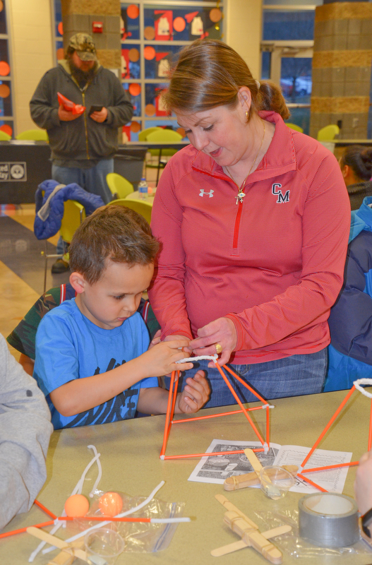 Third-grade teacher Kim Kolidakis helps kindergarten student Frankie Rossodivita with an arts-and-crafts activity at Campbell Community Night at Campbell K-7 School on Thursday, March 15, 2018...Photo by Scott Williams - The Vindicator.