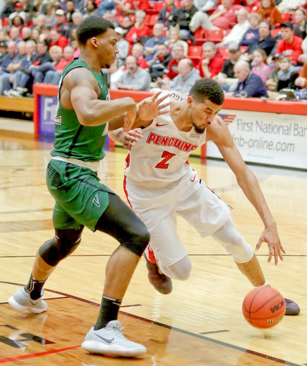 Youngstown State forward Devin Haygood (2) drives past Cleveland State forward Evan Clayborne (22) during their Feb. 24 game at Beeghly Center.