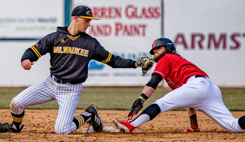 Milwaukee's Trevor Schwecke tries to tag out Youngstown State's Jeff Wehler at second base on Saturday during their doubleheader at Eastwood Field. In game two, Wehler was three for four with two doubles and three RBI.