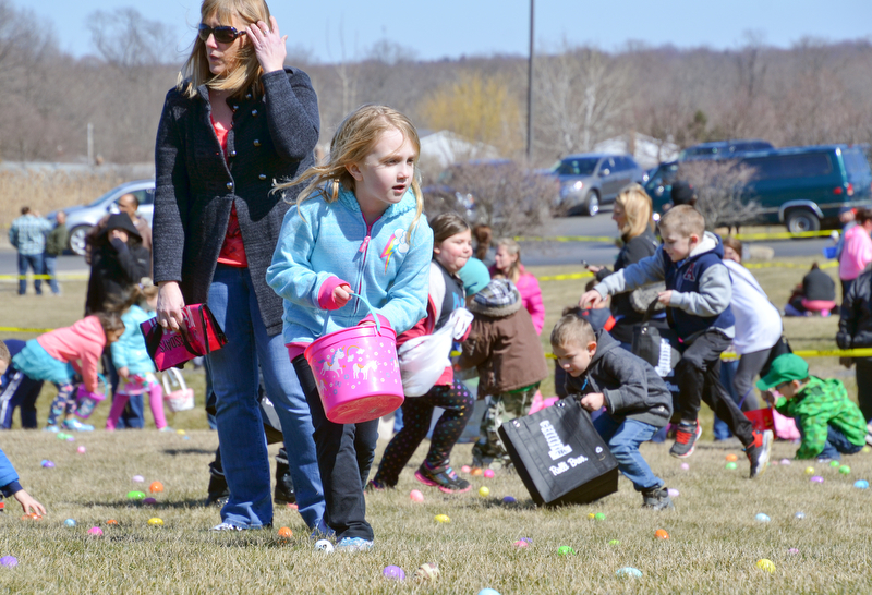 Maci Sankey, age 6, hunts for Easter eggs at Rulli Brothers in Boardman on March 18, 2018.  Her mom Jen Sankey, of New Castle, is right behind her to help.