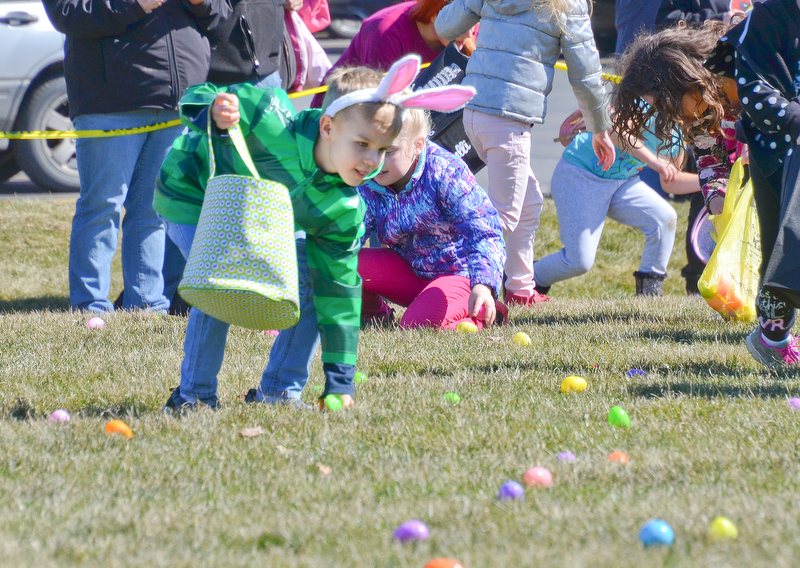 Carter Schultz, age 7, sports some nice bunny ears as he hunts for Easter eggs at Rulli Brothers in Boardman on March 18, 2018.  Kevin and Mary Schultz of North Jackson brought their sons Carter and Elliot, age 4.