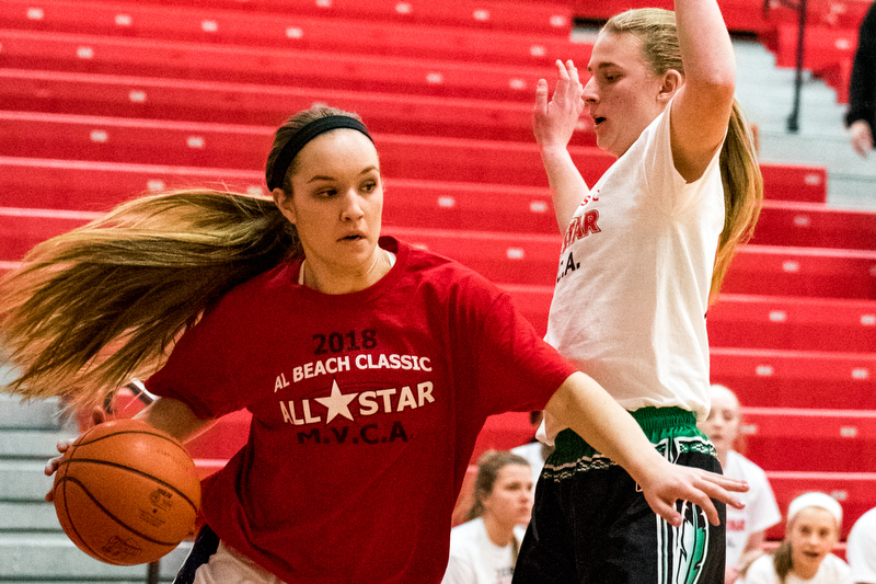 Champion's Megan Turner drives against West Branch's Kayla Havorka during the Al Beach All-Star Classic on Tuesday at Canfield High School.