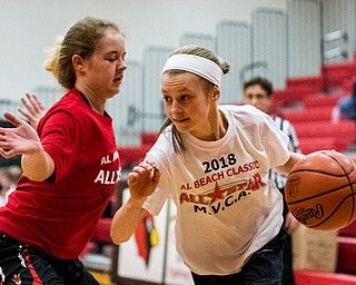 Poland's Bella Gajdos drives the baseline against Lordstown's Jordan Beach during the Al Beach All-Star Classic on Tuesday at Canfield High School