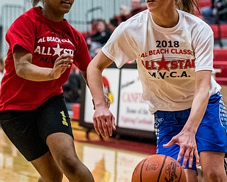 Warren Harding's Brayleonna Woods guards Jackson Milton's Michaelina Terranova as she drives toward the basket during the Al Beach All-Star Classic held at Canfield High School on Tuesday.