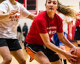 Newton Falls' Izzy Kline looks to the basket as South Range's Maddie Durkin defends during the Al Beach All-Star Classic at Canfield High School on Tuesday..