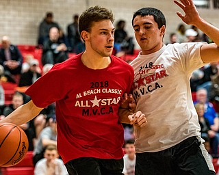 LaBrae's Aaron Iler drives the baseline against defensive pressure from West Branch's Michael Boosz during the Al Beach All-Star Classic at Canfield High School on Tuesday.