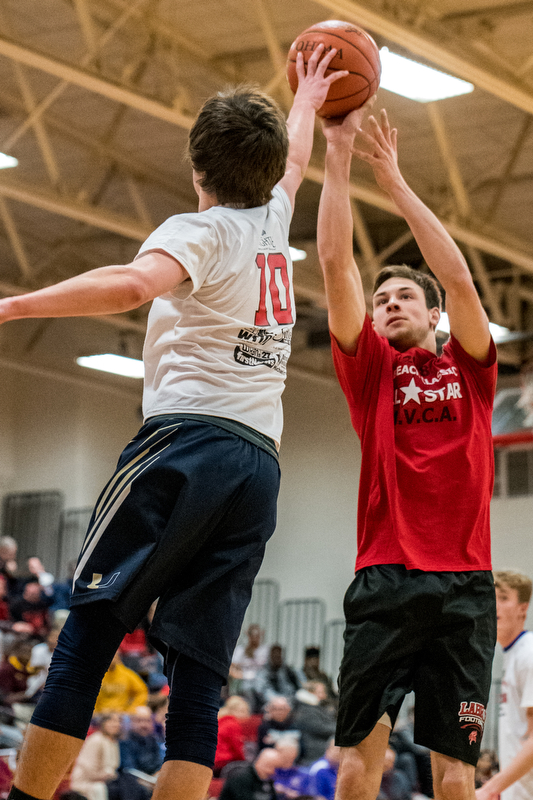 United's Kaden Smith blocks the shot of LaBrae's Aaron Iler during the Al Beach All-Star Classic held at Canfield High School on Tuesday