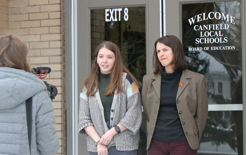 William D Lewis The Vindicator Canfield HS 11th graders Sydney Karlock, left, and Gabriella Sammarone are videoed by 12 th grader Emma Kadilak outside Canfield BOE office 3-21-18. Several students attended the BOE meeting to voice concerns about student saftey.