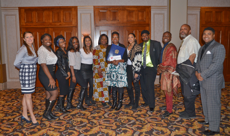 Dr. Sherri Harper Woods, center, stands with new and old staff members from Upward Bound at the Diversity Leadership Recognition Dinner at Stambaugh Tyler Grand Ballroom on Thursday, March 22, 2018.