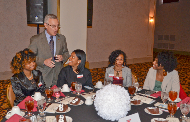Youngstown State President James P. Tressel chats with (L-R) Jasmine Harper, sophomore, Nylauna Petty, freshman, Shantia Cox, sophomore, and Jasmine Smyles, sophomore, who are Navarro Executive Fellows at the Diversity Leadership Recognition Dinner at Stambaugh Tyler Grand Ballroom on Thursday, March 22, 2018.