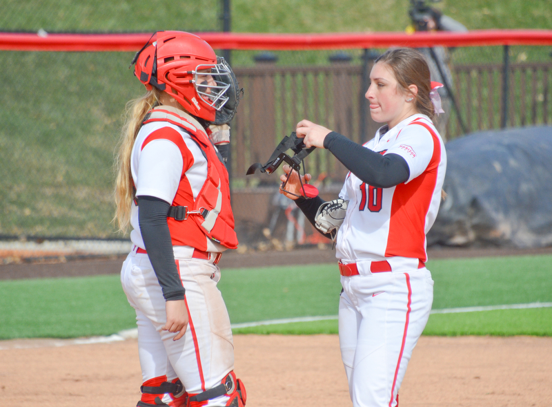 Nikki Saibene, #13, left, calls time for a trip to the mound to see Maddi Lusk, #10, during game two against Indiana University-Purdue University Indianapolis March 24, 2018 at the Covelli Sports Complex at Youngstown State University.  Photo by Scott Williams - The Vindicator