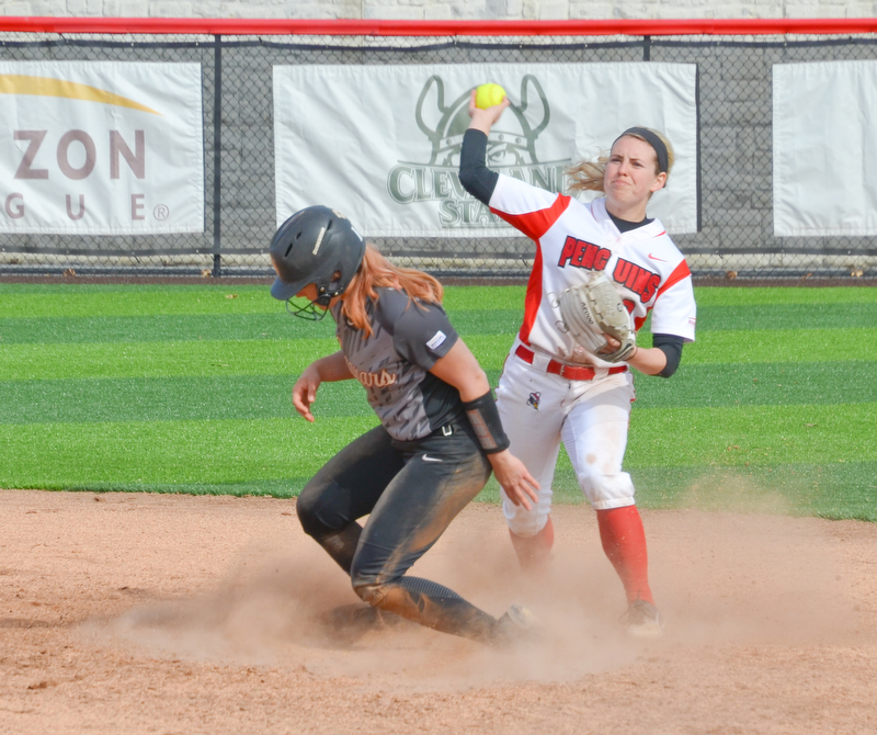 Youngstown State's Alexis Roach, #8, tries to turn a double play after forcing Kristin London, #14, out at second during game two against Indiana University-Purdue University Indianapolis March 24, 2018 at the Covelli Sports Complex at Youngstown State University.  Photo by Scott Williams - The Vindicator