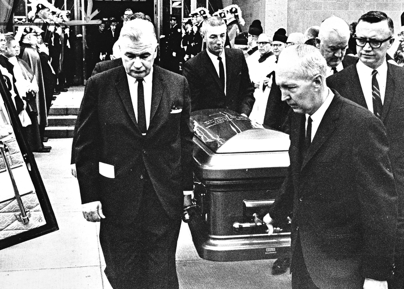 Pallbearers and funeral directors prepare to place the casket containing the body of Bishop Walsh, shepherd of nearly 300,000 Roman Catholics in the six-county Diocese of Youngstown, into the hearse for the trip from cathedral to Calvary Cemetery, which final rites were offered by Bishop Malone.  Carrying the bronze coffin are (left to right) James P. Griffin, steelworkers union leader; John E. Fox, president of the Fox Funeral Home; William Towell of Canton and Atty. Robert M. Murphy of Youngstown, pallbearers, and Joseph Vaschak, owner of the Vaschak Funeral Home.  Photo taken March 23, 1968.  Photo by Paul R. Schell.